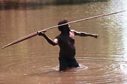 Photograph of George Manyita about to throw a 3-pronged fish spear