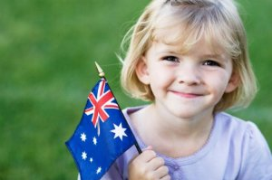 Young girl holding the Australian flag.